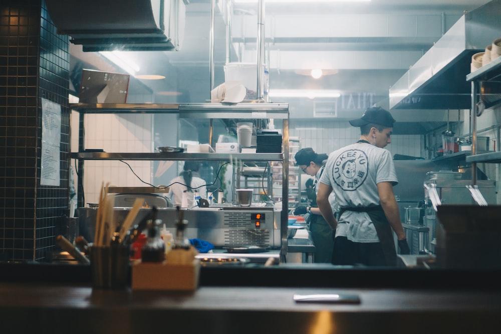 restaurant crews cooking inside kitchen