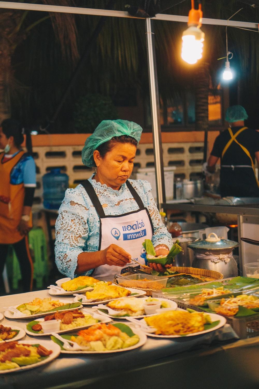 woman standing near food