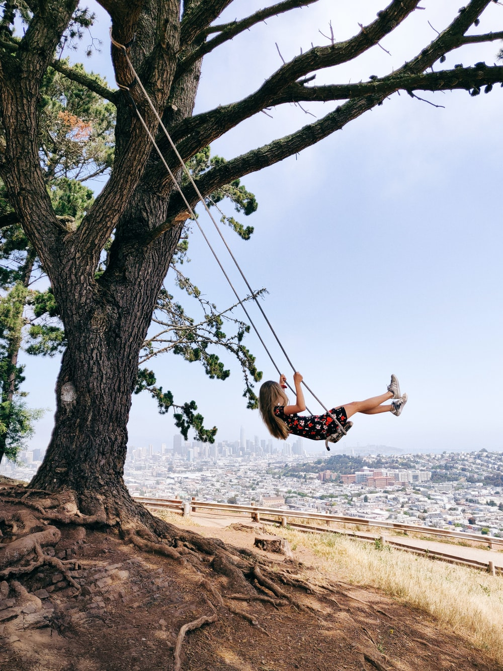 woman swinging on rope during daytime