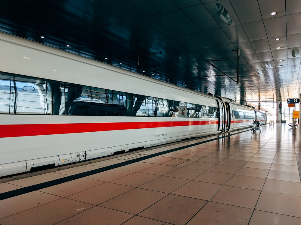 white and red train during daytime