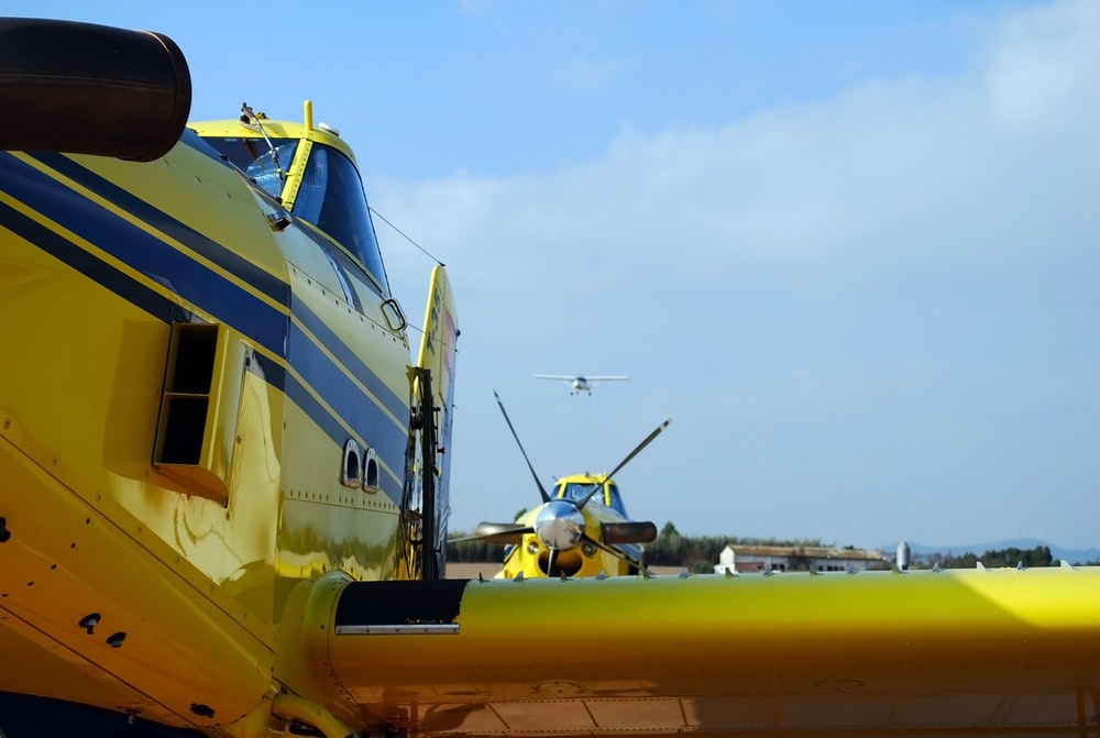 yellow and blue plane during daytime