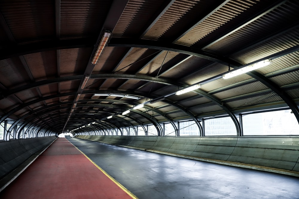 empty pathway under a metal ceiling