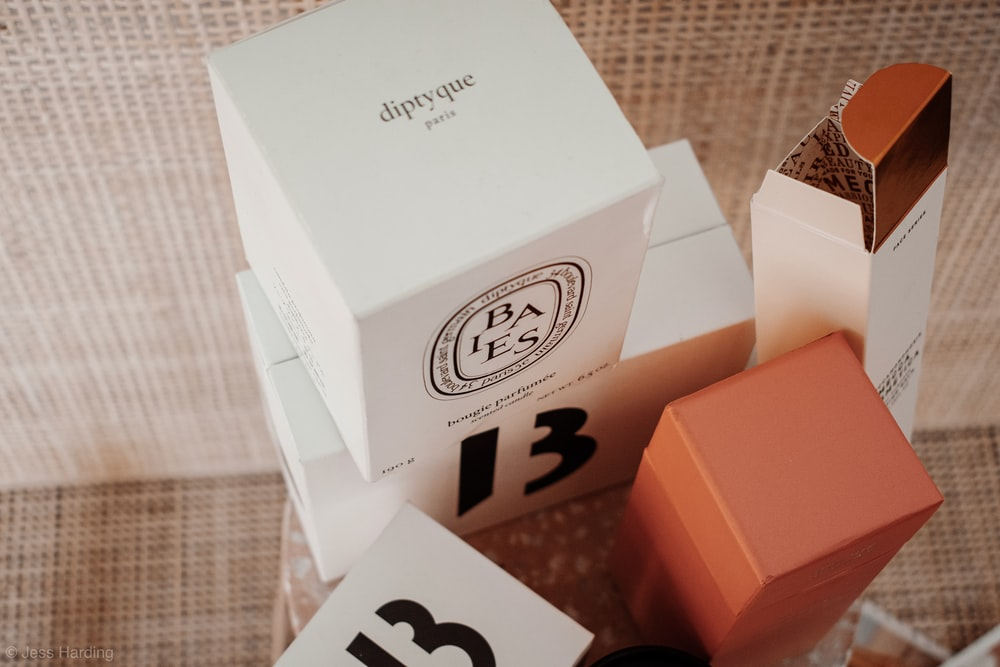 white and brown cardboard boxes