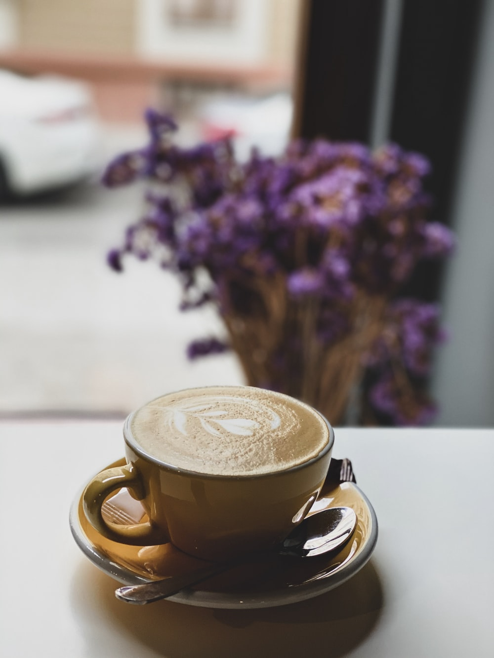 cappuccino in brown ceramic cup