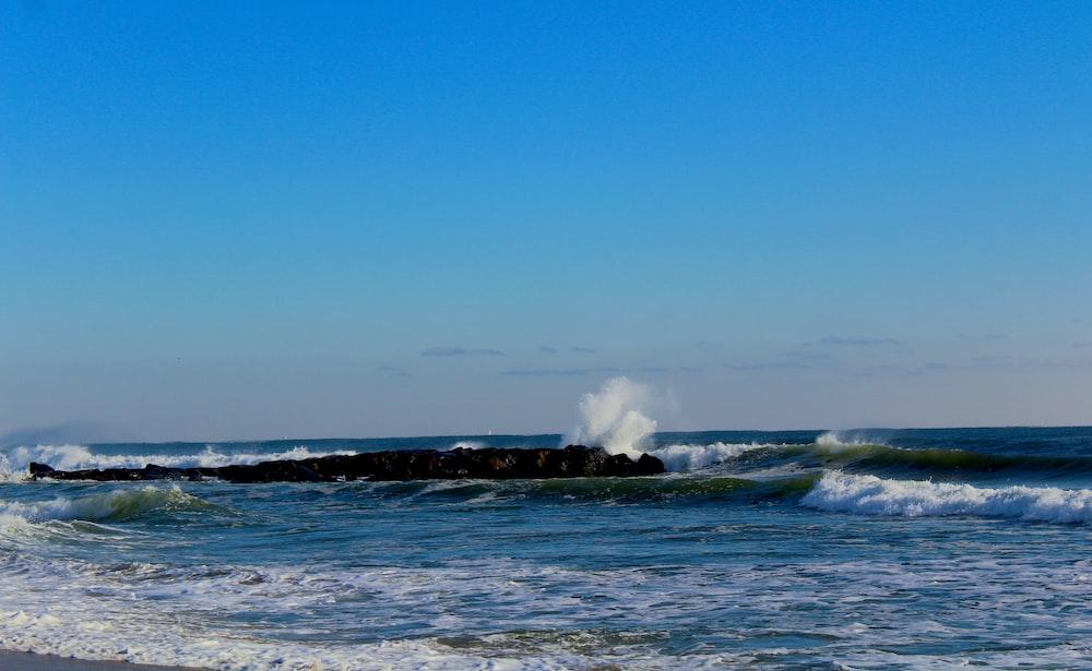 time lapse photography of blue waves splashing