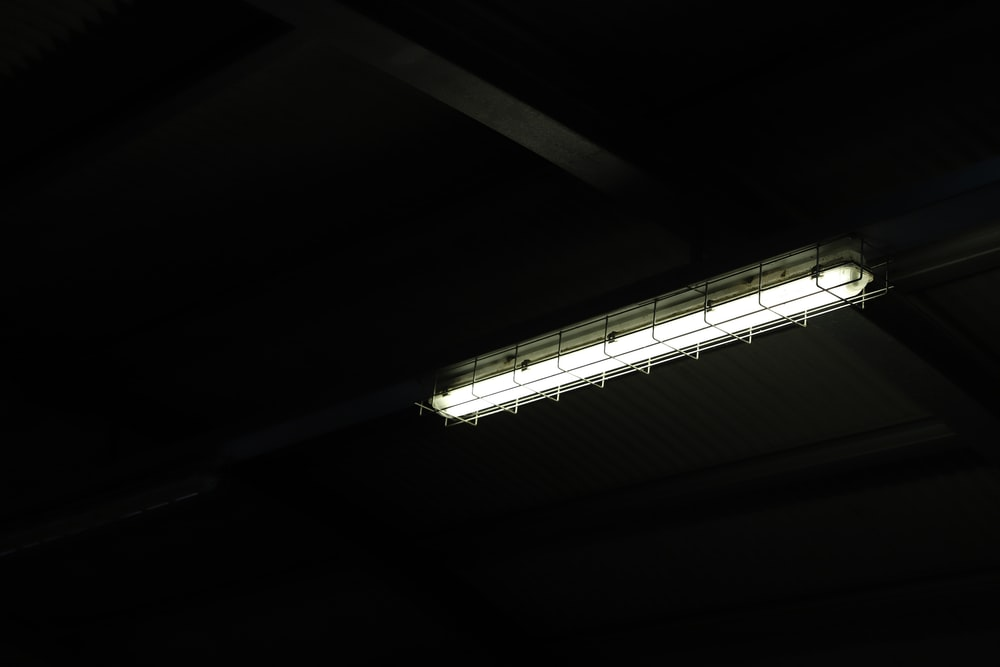turned-on fluorescent lamp