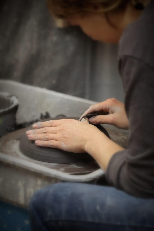 woman molding a clay