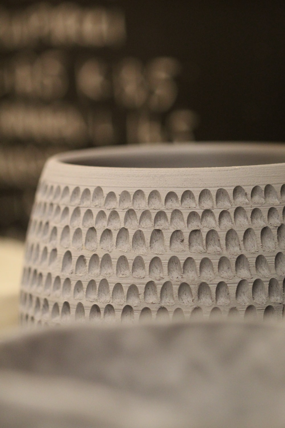 selective focus photography of round white ceramic container