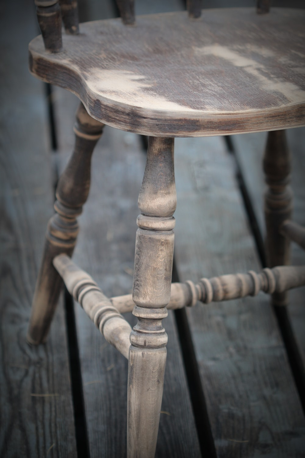selective-focus of brown wooden chairs