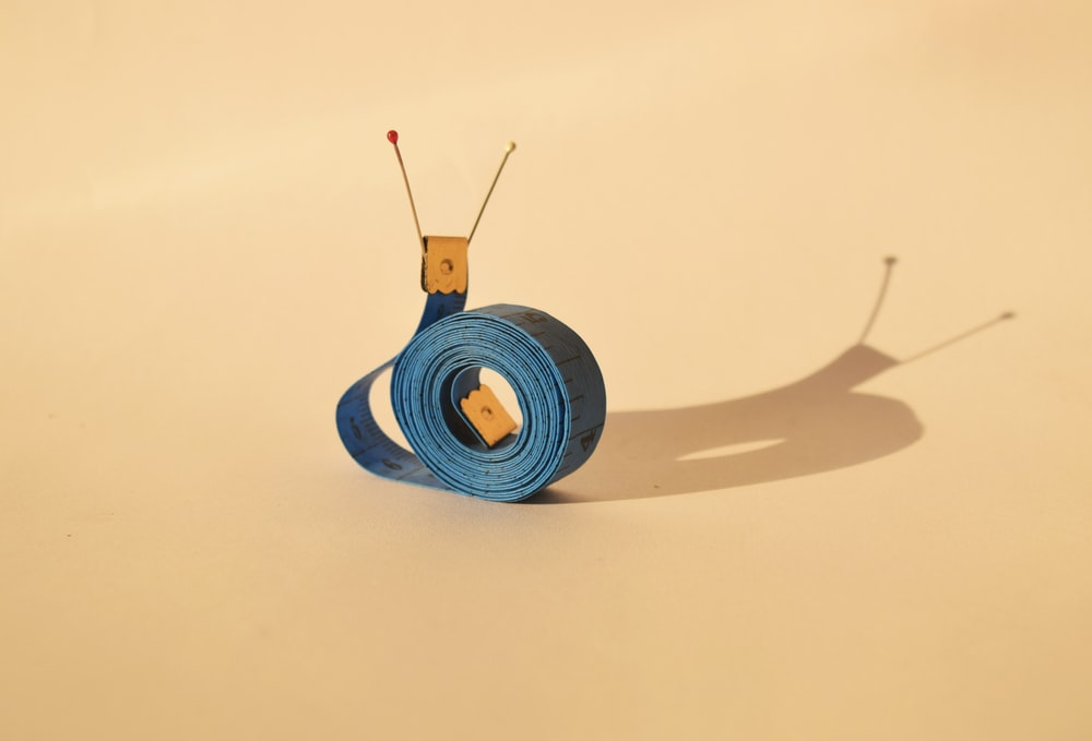 snail-shaped blue and yellow strap