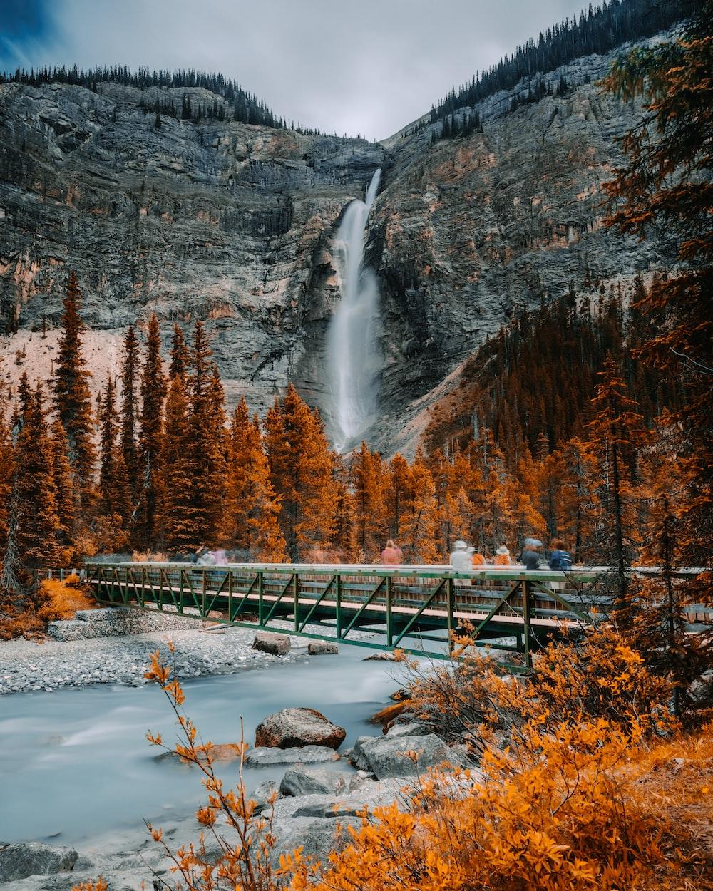 metal bridge near waterfall