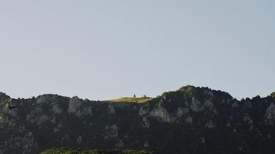 black rocks under grey sky bosnia and herzegovina teams background