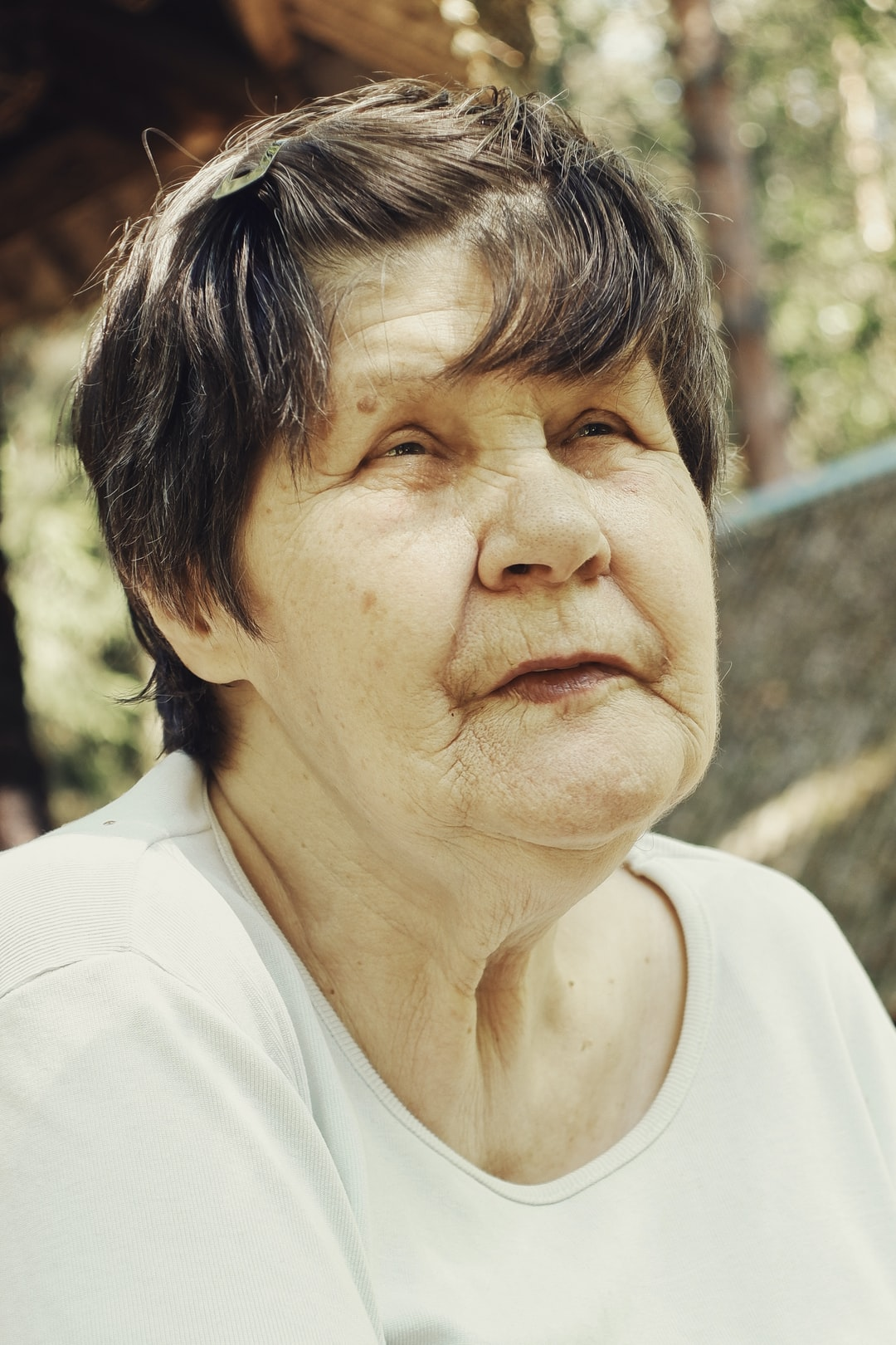 Portrait of an elderly pension age woman grandmother wearing a white shirt