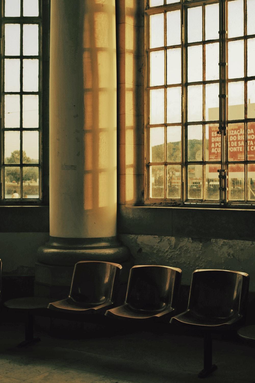 black gang chair beside window