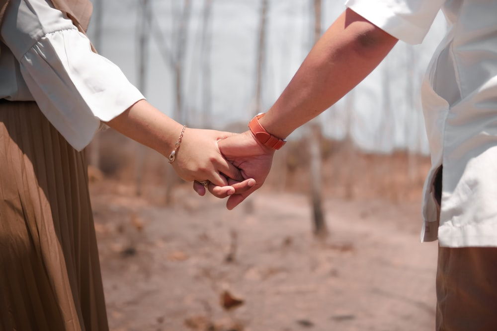 holding hand couple