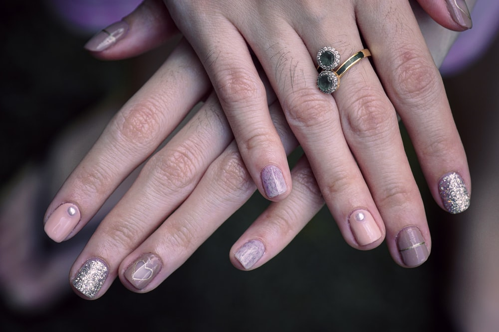 woman with manicure and ring