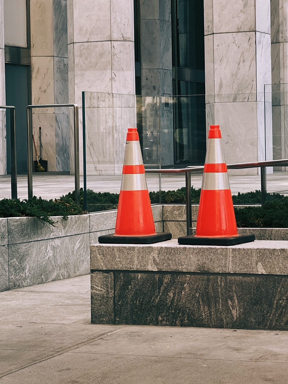 two red-and-white traffic cones