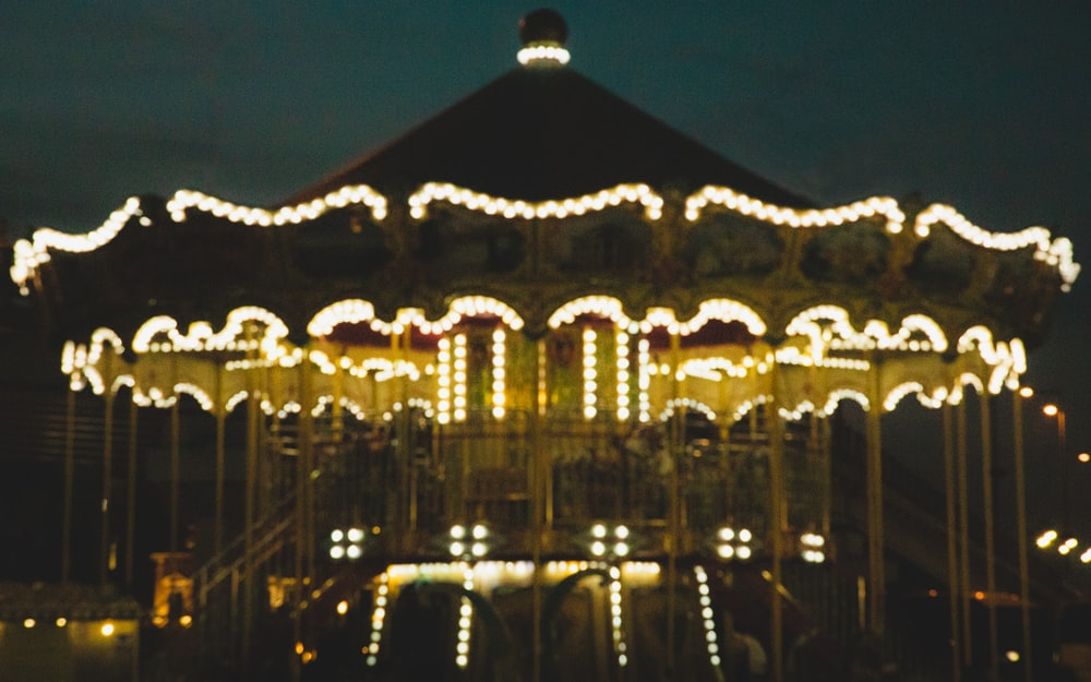 brown lighted carousel during nighttime