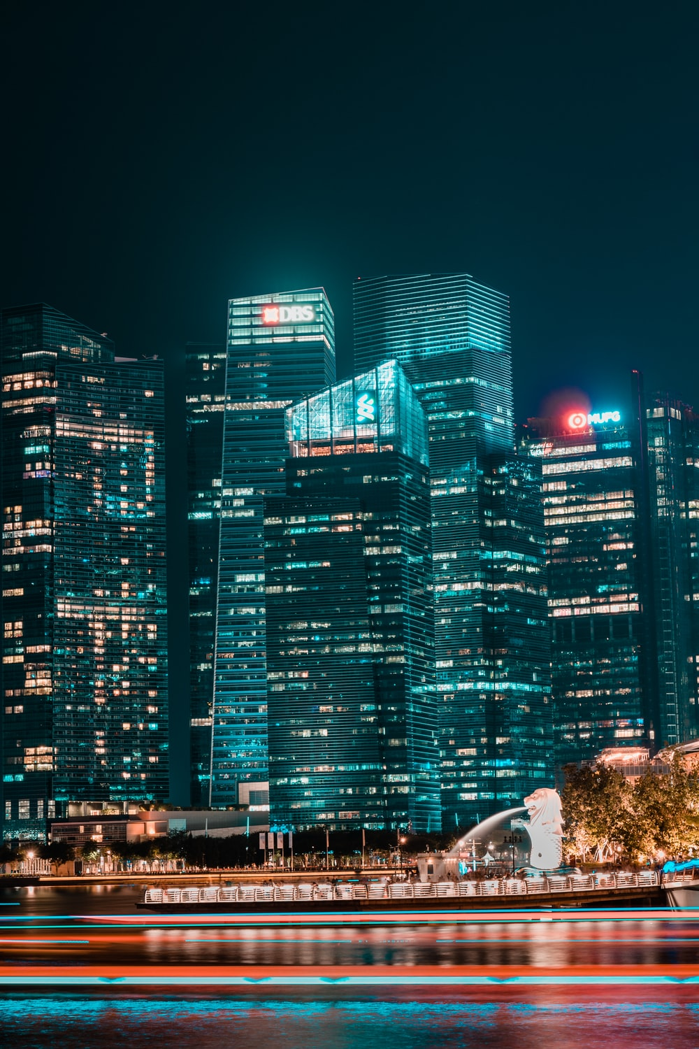 view photography of city high rise buildings during nighttime