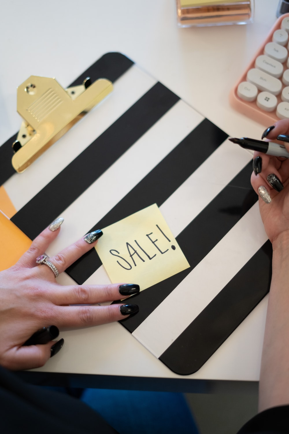 person writing sale sign