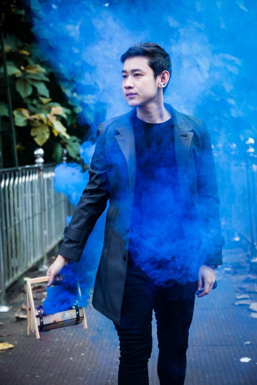 man holding box with blue smoke