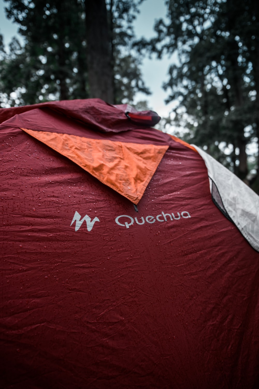 red and gray Quechua tent