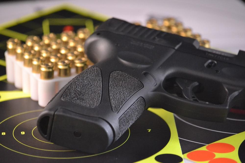 black pistol beside bullets