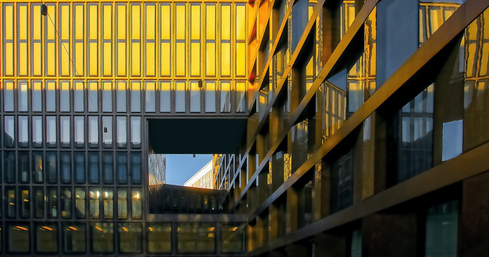 high-rise glass building during golden hour