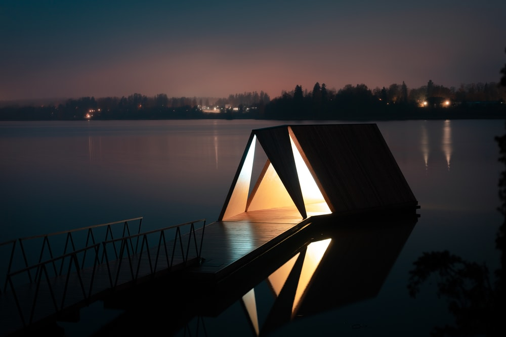 brown wooden dock at night