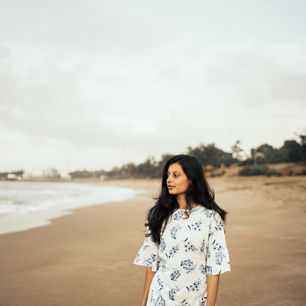 woman standing near beach line