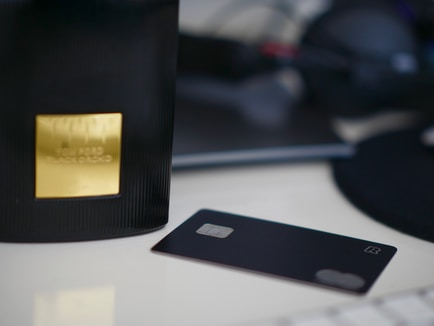selective focus photography of black card on white table
