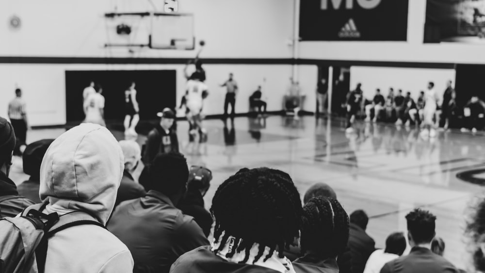 grayscale photo of a basketball game