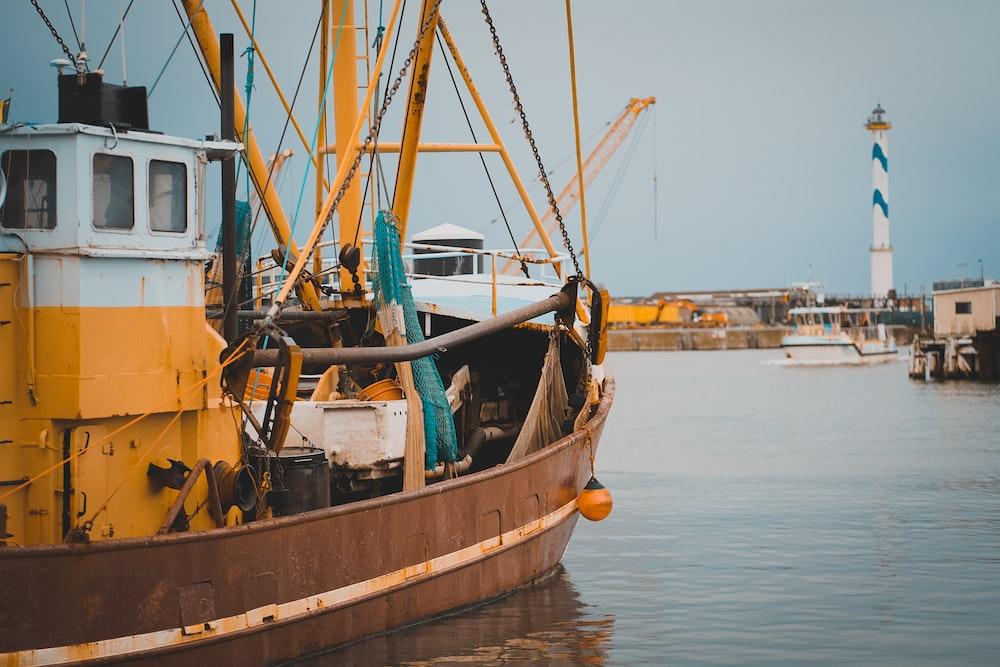 brown sailboat at a dock