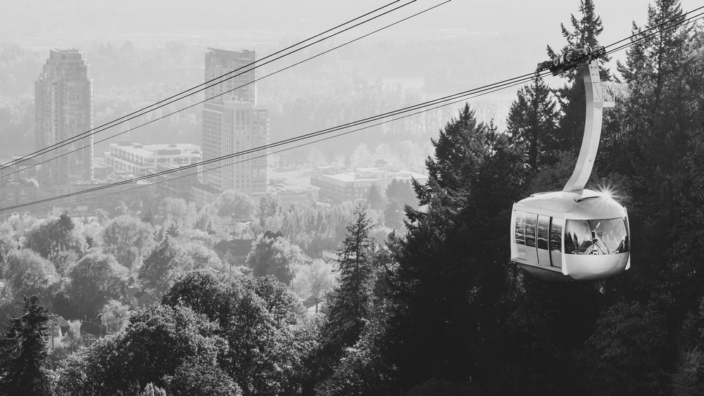 greyscale photography of cable car