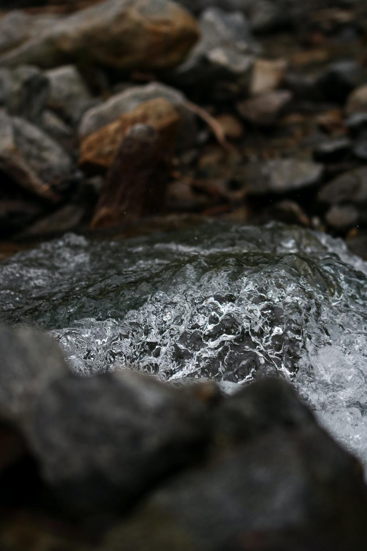 flowing river near rocks