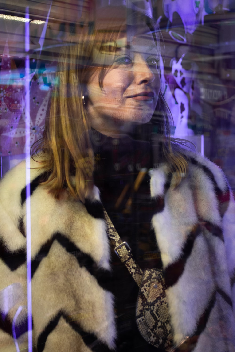 woman in a black and white fur jacket