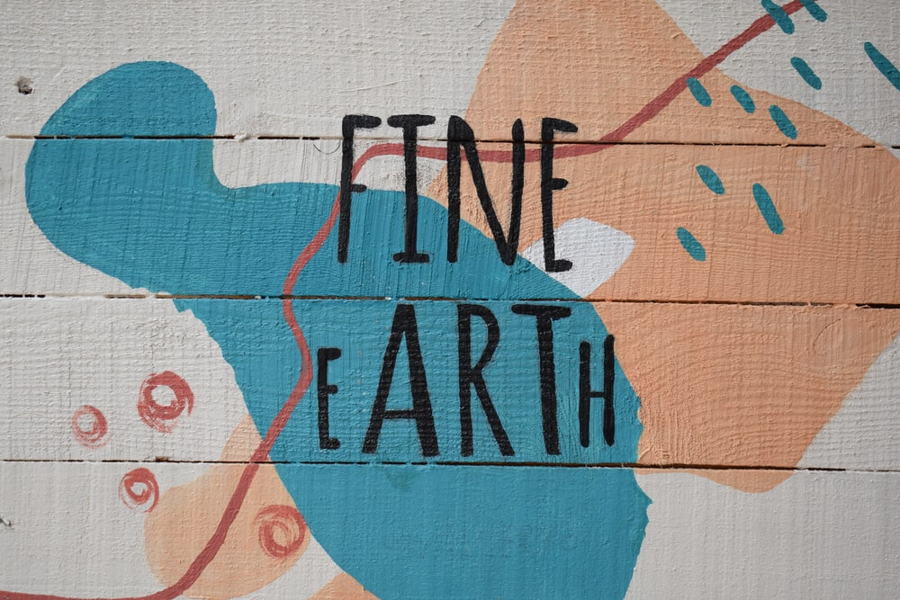 wooden surface with fine earth text signage