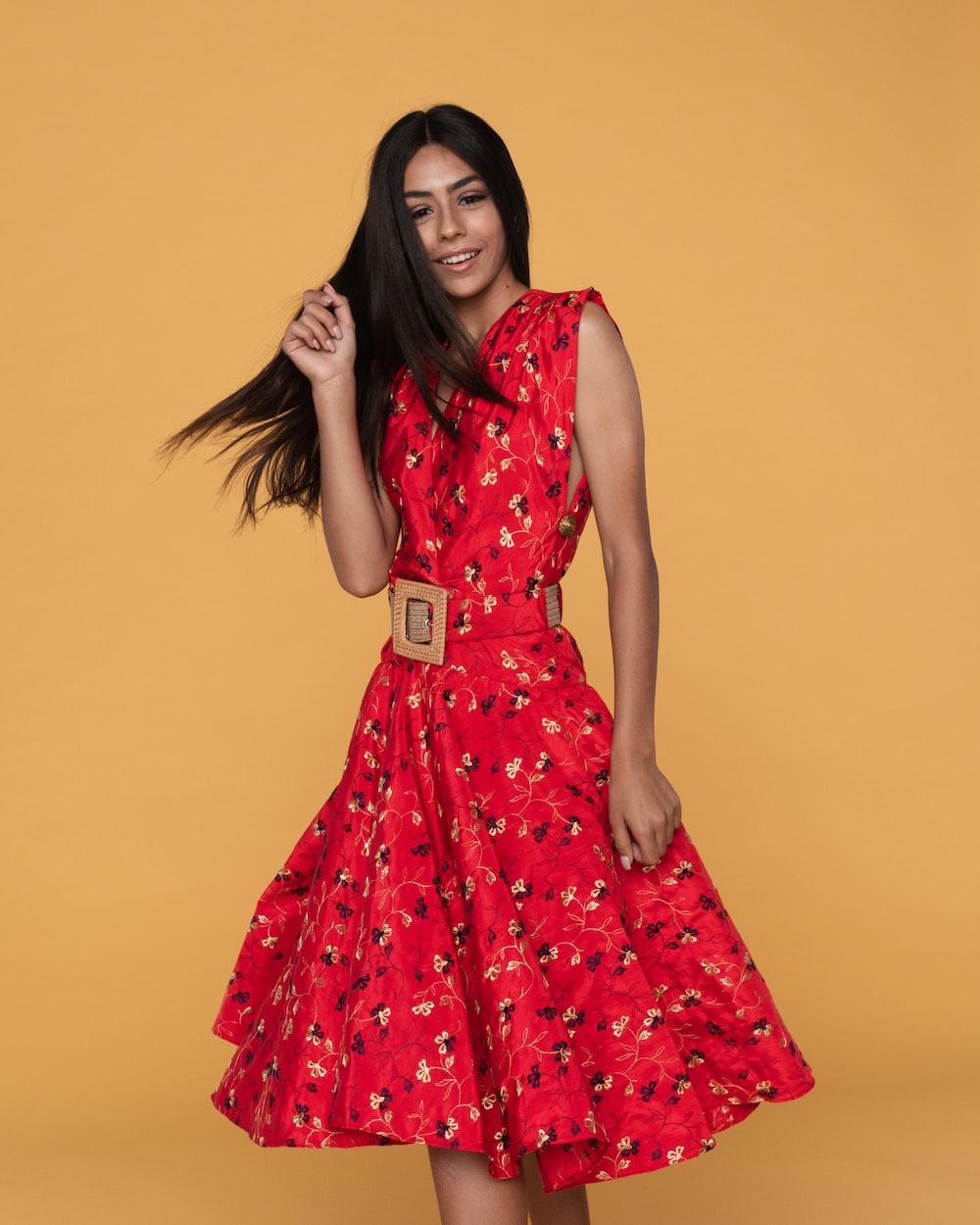 woman wearing red floral sleeveless midi dress