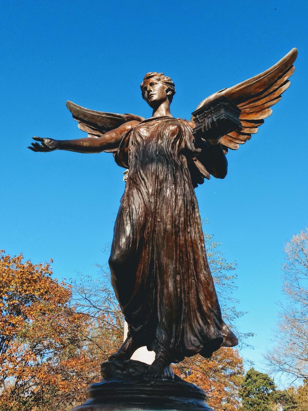 female angel statue under a calm blue sky