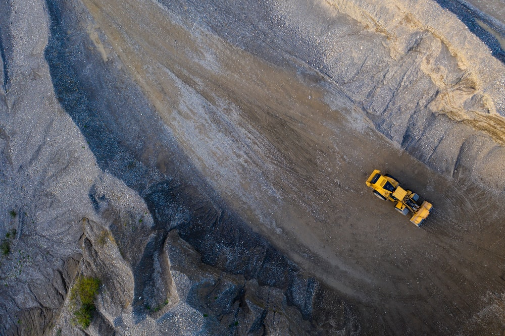 aerial photography of yellow heavy equipment on road during daytime