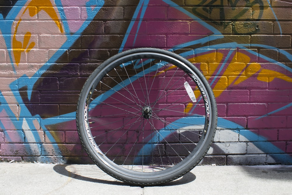 black bicycle tire with rim