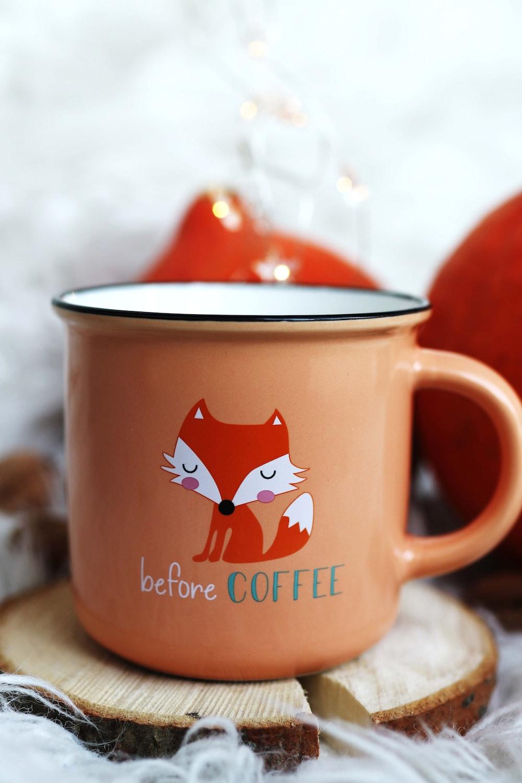 orange, red, and white fox before coffee print mug