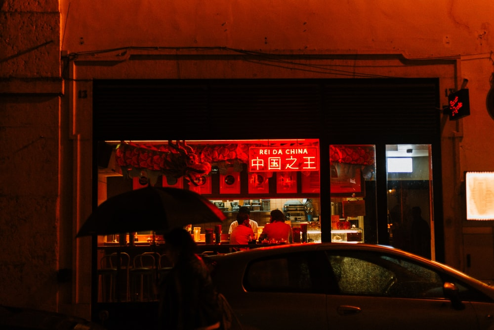 red neon sign on a Chinese store