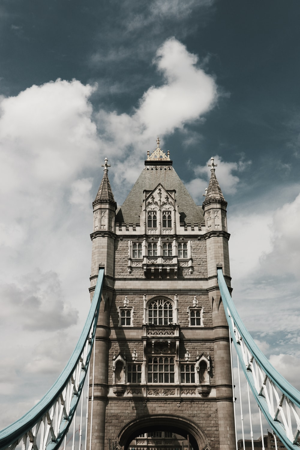 Tower Bridge in London under white and blue sky during daytime