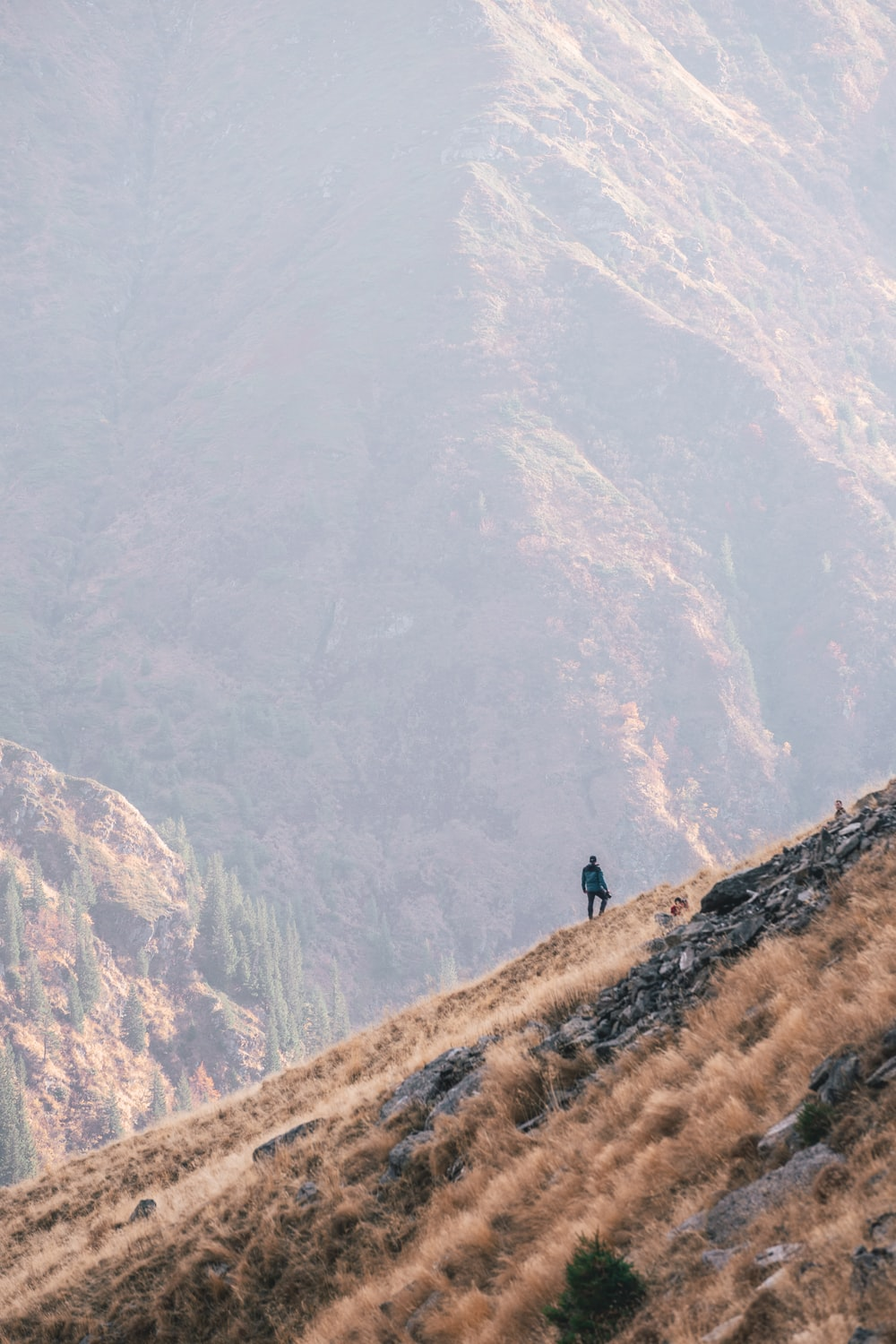 man by a mountainside