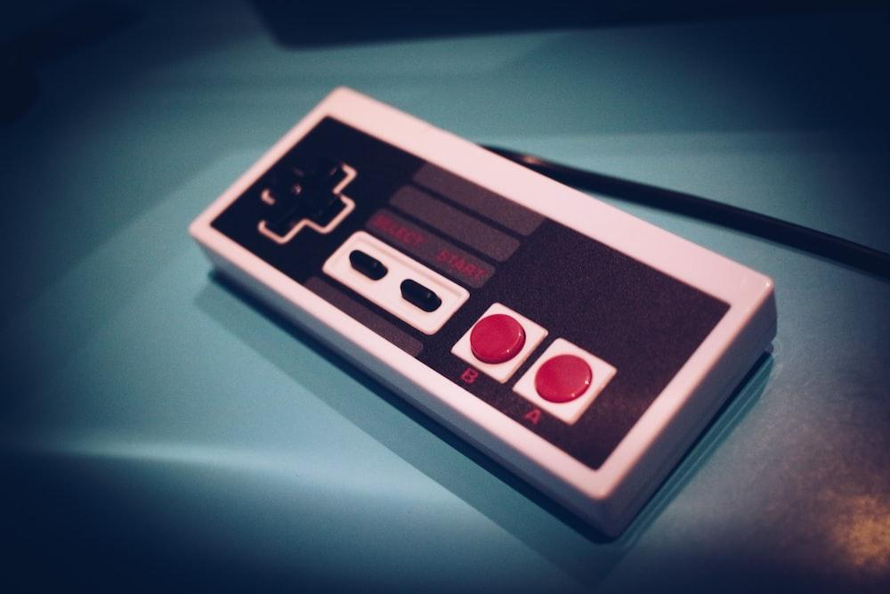 black and gray Nintendo SNES controller