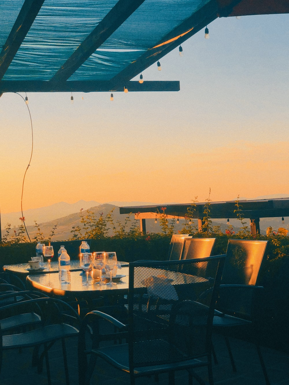 outdoor dining set with bottled water on top viewing mountain