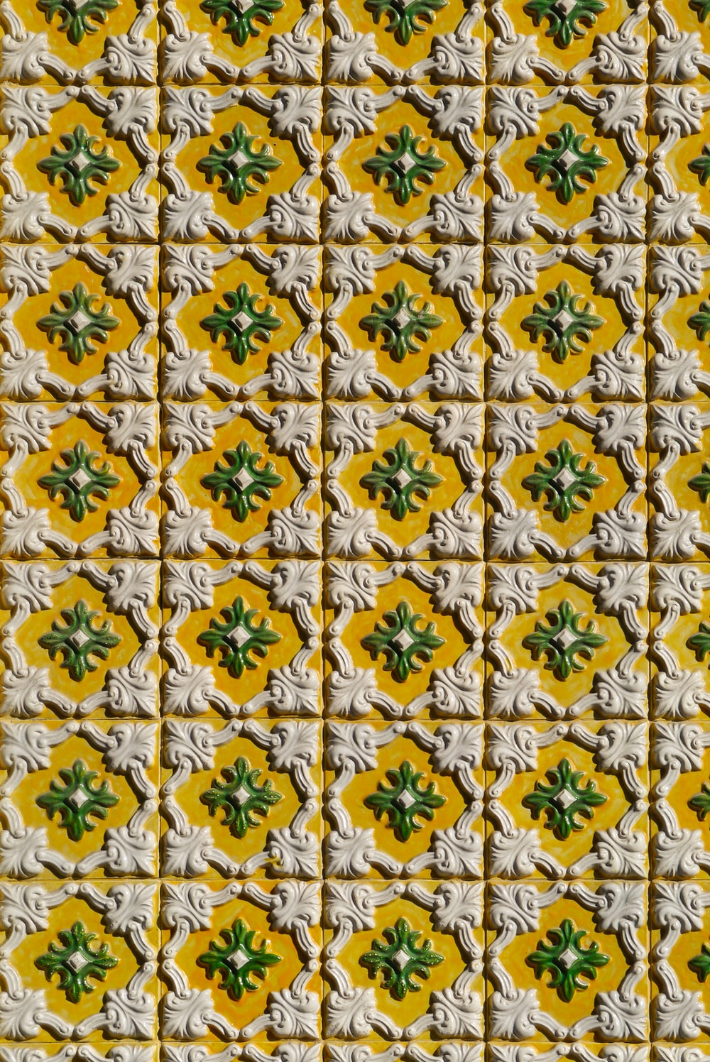 white, green, and yellow floral board
