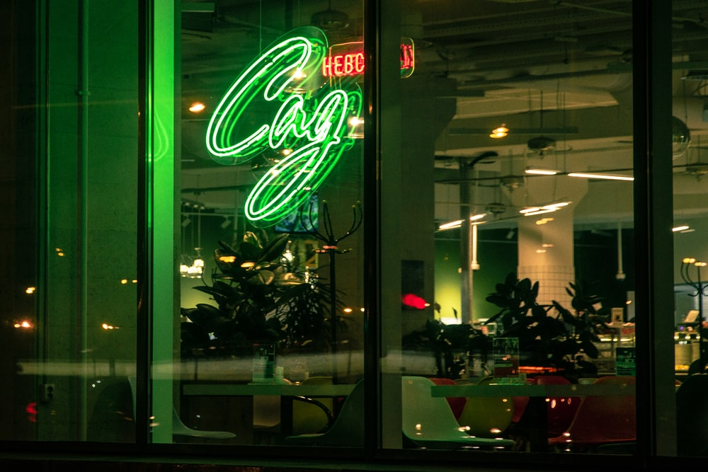 green letters neon sigange