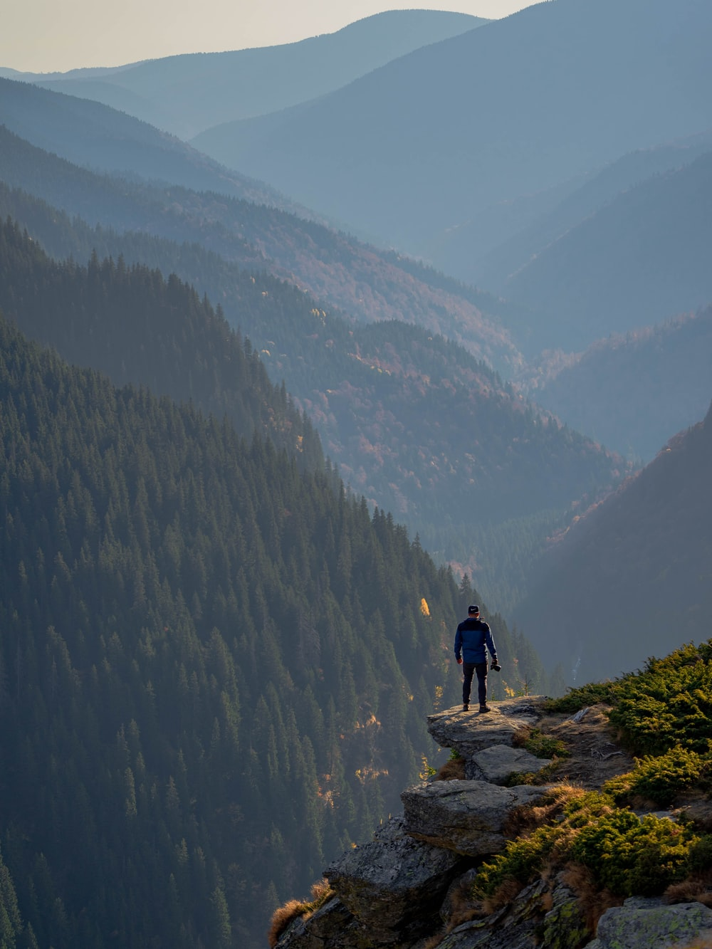 man standing near cliff edge